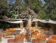 The orange open living room at Hotel Su Gologone in Oliena